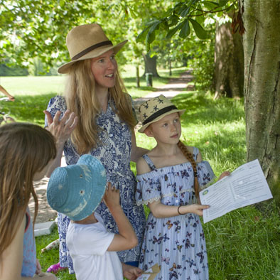 Giving out our Summer Eco Challenge in the park